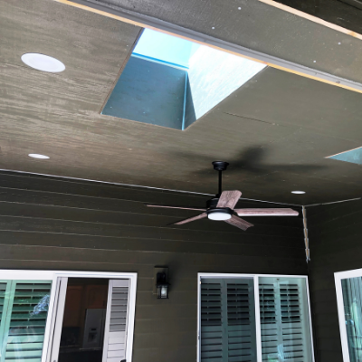 Ceiling fan and recessed can lights in outdoor covered patio in Tualatin by Classic Electric
