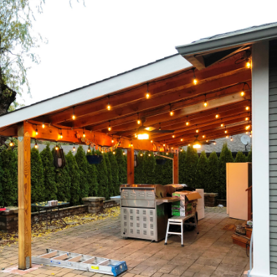 String lights and ceiling fans in outdoor covered patio by Classic Electric in Sherwood