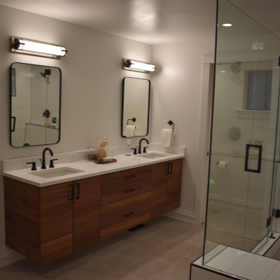 Bathroom remodel with vanity lights, recessed can lights, and receptacle outlets in Tigard by Classic Electric