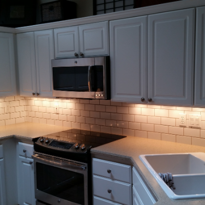 Kitchen remodel under-cabinet lights and GFCI plug in Sherwood by Classic Electric